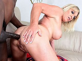 A big, black cock for Brandis tight ass : Brandi Jaimes seduces the pool guy, sucks and fucks his big, black cock and has him shove it deep inside her tight 50-year-old ass in her return visit to 50PlusMILFs.com. As youll see, shes not in our studio. Shes at the pool, wearing a skimpy bathing suit and enjoying a hot, sunny day in South Florida. Brandi makes any day anywhere hotter. The woman could melt snow at the North Pole. And speaking of poles...br br We love that Brandi used to be a stripper and was, in fact, a MILF stripper. We love the interview video at 50PlusMILFs.com in which she demonstrates how she gives a lap dance and also shows off her splits. Whats so great about Brandi doing a split? Shes not wearing panties.br br Anyway, Brandi is a wife, mother and grandmother. Shes blonde and has big tits. She has a very sexy, raunchy way about her. But there are other things you might like to know about her.br br She enjoys boating, swimming and fishing. Anything to keep me outdoors and in or on the water, she said. I enjoy music, too country, oldies, funk, jazz. Even some pop music.br br She likes watching football and NASCAR, so you can enjoy Brandi even when youre not fucking her.br br She told us that when she wants to feel sexy, she puts on her high heels and sexy clothes or I wear nothing at all. I love cleaning my house naked.br br Lucky husband. And when she bends over to pick up something off the floor, he can pop his cock right into her ass. Brandis okay with that. Great woman.