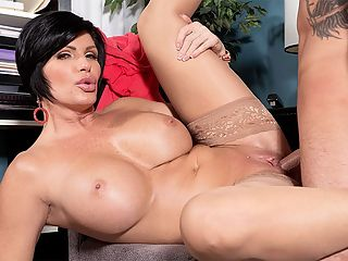 Shays office creampie : Shay Fox, a big-titted 45-year-old divorcee, sucks and fucks cock and gets a creampie in this scene, but we thought youd like to know a little bit more about her.br br Shes from Southern California, born and raised.br br Shes divorced. Shes also a mom.br br Her tits are DDD-cups. Her pussy is shaved.br br She describes her special talent as giving sloppy blow jobs.br br We asked her if she was the bustiest girl in school, and she said, No, the redheaded girl was. But were betting the redhead girl doesnt look as good now as Shay does.br br She works out. A lot. Shes a fitness competitor. You can tell by her body.br br She doesnt watch sports, but she loves men in tight pants.br br She enjoys having her asshole licked.br br Sex in public places?br br Sure! Nowhere is out of the question.br br Were glad to hear that. Were glad she decided to have sex in our studio. So was the guy whos fucking her in this video. They have office sex. Shay is the sexy office hottie in a tight top. Shes fucking herself with a dildo right there in the office when one of her co-workers walks in.br br Shay, youre going to get fired if you keep doing this! he warns her.br br No biggie. Her side job as a porn star is a lot more fun.