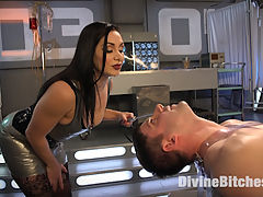 Lea Lexis Presents Her Futuristic Medical Fetish Dungeon : The gorgeous Lea Lexis turns Rick Fantana into her little bitch all bound and humiliated on a gynecological chair in her futuristic medical fetish dungeon! This pathetic man slave screams for corporal punishment, intense tit torment, and extreme cock and ball suffering. Lea takes a spiked roller to his delicate body which immediately gets the precum flowing for her pleasure. After squeezing his pathetic testicles again, she smothers him with her pussy face sitting. Next his asshole needs some work, after a butt plug is removed she rams a metal rod straight up his ass. This gets his sad cock rock hard and he is ready for some deep strap-on pegging which causes his eyes to bulge out of his head before he is allowed to release his huge load all over his own face. Pathetic.