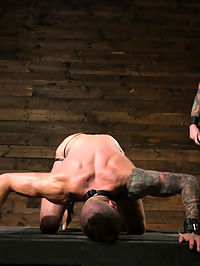 Muscled hunk begs for his masters abuse : Leather slave, Dolf Dietrich awaits on bended knee for his master Christian Wilde, begging to feel his touch. Mr Wilde obliges with heavy punches to Dolfs muscled torso before working up his fat cock. Begging for abuse, Dolf endures the cat-o-nine tails before hes bound to the wall, with a gag lodged in his mouth. Drooling all over himself, the bound slave takes a relentless flogging, the blindfold covering his eyes making it impossible to anticipate each blow. Dolf is rewarded with servicing his masters rock hard cock and taken over to the bed. A row of clothespins line across Dolfs muscular ass, his hole exposed as Christian crops each one off. For a final reward, Christian pounds his slaves hole before erupting a huge load across Dolfs face.