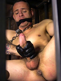New boy with a big cock at Mr Ducatis mercy : Locked in a cage, Nate awakens to find himself with a chain around his neck as his tormentor, Trenton Ducati, approaches. The sadistic leather dom grabs his boy by the chain and smashes his face against the bars, relentlessly zapping him with electricity as Nate screams in agony. Now that he knows his place, Nate opens his mouth to receive Trentons fat, hard cock as it slams all the way down his throat. With a ball gag in place, Trentons new play thing is bound in full rope as he feels the flog whip against his flesh. Nates eight inch cock dangles between his legs as Trenton flogs and stretches the boys nuts before having a turn at his ass. After a thorough ass-flogging, Nate then feels the depth and stretch of Trentons huge toys shoved in his ass. But nothing compares once Trenton slides his hard cock deep in the boys ass, fucking him without mercy until Nate shoots his load all over the dungeon floor.