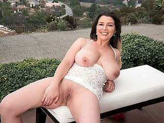 Boobs Brexit : New model Aurora Rose gives us a narrated tour of her big, bouncing British boobs in and out of brassieres and lingerie. The view is refreshing.br br So what kind of bra does Aurora wear to secure her hooters?br br I found one bra that does the trick, said Aurora. Its the Cleo by Panache, Marcie Balconette bra. I just order it online in different colors. I dont dress to emphasize my breasts but I make sure that nothing I wear hides the lovely fullness and roundness of them. I love high-cut dresses and tops that are tight that show off their shape.br br Aurora gets a lot of attention but she doesnt believe its all about whats upfront. Our photographer agrees and reports that, Aurora has the kind of personality thats bubbly and enjoyable. She bounces into a room and lights it up.