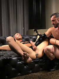 Lust for Latex : A bronzed, muscular slave stands clad in latex and bound in rope, awaiting the ministrations of his master. First, his large cock is unzipped from his tight rubber shorts and his chest, cock and balls are cropped mercilessly before his well-hung master decides it is time to fuck his subs face with his hefty dick. Next our hot latex slave is suspended and subjected to intense ball stretching and flogging, his screams echoing as he struggles helplessly at the mercy of his master. A harsh metal electrostim butt plug is inserted in the slaves hungry asshole and his hard cock bounces as his prostate is shocked again and again, though nothing could prepare his hole for the hard, fast fucking he receives from his masters huge cock - while being shocked and fucked the slave cant contain himself any longer and blows a huge load all over himself, only to get even messier with his masters thick hot cum.