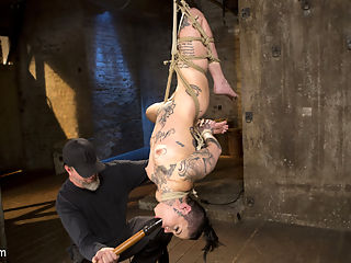 Tattooed Pain Slut Endures Brutal Bondage with Agonizing Torment : Welcome newcomer, Leigh Raven to Hogtied. She has an amazing body, beautiful face, soaking wet pussy, and cool tattoos. She is a self proclaimed pain slut, so we jump right into the torment. Her body is put through grueling bondage positions, with each one pushing her body more than the last. The torment is nonstop and keeps her on the edge of tapping out, but The Pope always pulls back just in time to preserve the moment and allow us to see more of her suffering.