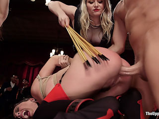 Holiday BDSM Slut Orgy turns Fangirl to Sex Slave : The decks are stacked for sexual deviance in this Holiday Upper Floor affair. Aiden Star has a greedy TUF fangirl Kimber Woods in her clutches, and that fit little bitch is going to earn every inch of dick. Upper Floor favorite Roxanne Rae is gobbling up cock like its her last meal while the crowd cheers her on and laughs at Kimbers desperate attempts to shake her ass, beg, grovel, and lick shoes to get the cock. Thoroughly humiliated by the crowd of BDSM swingers is the only way that horny little cunt is getting anything. Meanwhile, hot lady guests ride the fucking machines and their Masters dicks. Dominant women spank their subs asses red while some truly inspiring shibari rope suspensions lit the room up. We are gifted with guests of honor Jack Hammer and Barbary Rose who are a real life Ds couple. Jack stuffs Barbarys throat with cock, ties her wide open and punishes her pussy with electrical shocks, slaps, and teases her with orgasm and sex until she is begging for Daddys dick. Kimber entered her training, but how will she beg her way out of the terrible flogging and crop punishment she has earned by not knowing the rules. Her slutty senior slave Raoxanne is way too busy getting her tight little ass pounded to even notice her slave sisters plight- that is until the cane comes her way...