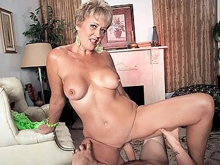 Tracy licks, sucks, fucks and gets a creampie : Ive got myself a nice, hard, young cock that Im going to suck and fuck while youre watching me, 52-year-old wife and mother Tracy Licks says. I cant wait to get my mouth around that cock.br br No need to wait, Tracy. Go right ahead! Shes certainly dressed for sex in a tiny green lingerie number that barely covers any of her smoking hot body.br br Are you going to stroke your cock while Im sucking it? Tracy asks, looking right into the camera.br br Well, yeah. As a matter of fact, we are!br br Tracy fuck-talks her way through this scene as she has her way with JMacs big cock we never see JMacs face just his dick, and when JMac cant hold back any longer, he cums inside Tracys pussy and gives her a nice creampie.br