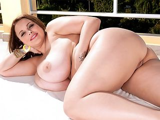 The Magnificence of Terri Jane : Terri Jane is absolutely the British girl-next-door. Very much like Ashley Sage Ellison, Kerry Marie and Chaz in so many ways. A girl-next-door with gigantic tits. Say your prayers and give thanks that she decided to show them. Most girls dont. br br I live in England. I live by Birmingham in a small town that is about 20 minutes away from Birmingham. I live with my family and my dog.br br I get guys who come up to me all the time and say things like, Take your boobs out. They are not scared. I have had girls come up to me in the bathroom, asking me if they are real or if they are fake. Girls come up to me all the time, feeling my boobs. I cant stop them! They just walk up to me and grab them! So girls, too? br br What does a guy do when he sees Terris marvels? br br First they ask me to get them out and then they want me to bounce them up and down. Then they like me to get on top of them and drop my breasts on their face and jiggle them around a bit. Men like jiggling and bouncing boobs.br br br br