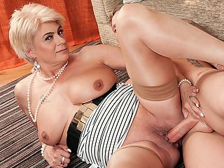 How to jack, suck and fuck a cock, by Dimonty : When 58-year-old British GILF Dimonty gets home early and catches her 33-year-old guy jacking off, she decides to teach him a lesson...a lesson in jacking cock, of course.br br Let me show you how its done, she says before leaning over to grab his knob.br br Thats a lesson any guy would gladly accept, especially if the woman doing the teaching is a 58-year-old hottie like Dimonty. Shes dressed to fuck with stockings and a garter. She has big tits and talks dirty when shes getting her cunt drilled. She also eats cum.br br We asked Dimonty how a guy gets her attention, and she said, By paying me a compliment. In this scene, the guy is paying her a compliment with his raging hard-on, and Dimonty is flattered. And when shes flattered, her pussy gets wet.br br Shes a wife, mother and grandmother, by the way. The guy shes sucking and fucking in this scene is easily young enough to be her son. Hes not, of course, but he could be. Interestingly, though, Dimonty said, I prefer older men with lots of experience. Well, isnt experience part of the reason we prefer mature women?br br Shes from London, England. Shes a swinger and a nudist. As for her wildest sexual encounter, she said, Having a man finger me on a packed train until I orgasmed. He put his hand up my skirt, hiding it under my coat.br br We assume this was a guy she knew before she boarded the train.br br Maybe, Dimonty said, smiling. Maybe not.br br Well go with not.br br br