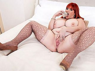 Roxee The Pleasure Seeker : Roxee Robinson has worn a lot of different outfits and costumes in her XL Girls scenes, but you know what? The redhaired Canadian MILF looks the hottest in a very basic, low-cut, one-piece dress that hugs her dangerous curves. Roxee gets into bed to pleasure her big nipples and her juicy, creamy pussy. Being watched adds to Roxees pleasure in ways she cant put into words.br br Wrote C.G., overpowered by her sheer sexual magnetism, Roxee Robinson is the kind of girl that dreams are made of. So womanly, so lush, so beautiful, with curves in all the right places. I adore her soft, white thighs. Her breasts are like giant pillows. Her eyes are gorgeous. She could look me in the eyes and make me cum. The fact that she is over 40 makes her even more attractive to me. The photos of her with all of her clothes off are so arousing because she displays such confidence in showing off her body. She is rightfully proud of how she looks. My hope is that youll continue to show her in XL Girls.