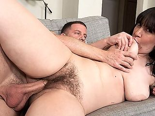 All-natural Gia does a big cock : She isnt a swinger. She isnt a nudist. Shes a 42-year-old cougar from Philadelphia born in New Jersey who has long, dark hair, big tits and a hairy pussy. And in this scene, she sucks and fucks a big, hard cock for only the second time on-camera. She does a really good job of sucking balls, too. Gia knows what shes doing. And she looks so good when her face is glazed with cum!br br Yes, this is Gias second time fucking on-camera, but she really takes control, stuffing her nice, floppy tits into Tonys mouth and riding him hard. She has a nice, big ass, too. Basically, if youre looking for a real woman whos natural in every way, Gias your MILF.br br And shes the MILF-next-door in every way. Shes not into any kinky fetishes. Shes never had sex with another woman. She says the people who know her best would be surprised to see her here and my family would not be thrilled.br br Hey, were thrilled, and isnt that what counts?br br I like to work out, and in my spare time, I like to spend time with family and friends, she said.br br Like we said, shes just your basic MILF-next-door...who happens to be doing this.br br This may sound boring, but Im really a basic girl, Gia said. I dont need anything crazy, just a man who enjoys himself with me.br br We can do that!