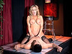 Busty Stripper Screwed On The Stage! : One of the sexiest and shapeliest iSCORE iMILFs in Florida Amber Lynn Bach is a real-life MILF, not a fake porn MILF. This scene fires a big pop shot in honor of this blonde bra-buster.br br Amber started as a big-titty stripper and lap dancer in Florida clubs before she became an amateur at-home web sensation with her horny fucking and toying shows. She is a very sexually-driven woman and keeps her body in top shape. br br Amber used to strip at Scarletts Cabaret in Hallandale Beach, Florida. Amber enjoyed the heavily sexualized atmosphere and oddly addictive lure of strip clubs where women could be whoever they wanted to be in dimly lit clubs and men could enjoy an endless parade of female flesh. If you have spent afternoons or evenings in strip clubs, you know the kind of sexual energy and tension that is in the air as soon as you walk in the door.br br Amber liked showing her body to strangers, knowing that they all wanted to fuck her or at least get next to her. It was a lot of fun, Amber remembered. I also danced at Rachels in West Palm Beach. Amber could easily go back to the strip club grind if she wanted but shes content with being a porn star and web-cam performer.br br The first part of Amber Lynn Bach Busty Stripper Screwed On The Stage recreates that horny ringside strip club experience. As for whether girls can or will actually fuck a total stranger on stage as happens in the second part, that all depends on the club a guy goes to.