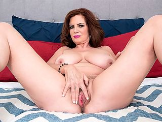 Andi James cums and makes fantasies come true : Andi James, a 52-year-old redhead with big tits, returns to i50PlusMILFs.comi. When this scene opens, shes wearing sexy, sheer lingerie that shows off her big tits and hard nipples. She pulls aside the crotch portion of the little number she has on so she can get to her pussy. Then she tells us about her fantasy. She wants a guy in his 20s, her sons age.br br Maybe hed like to get a piece of this, Andi says and she spreads her legs and fingers her hairy snatch. As Andi gets hotter and the sex talk heats up, she takes off her lingerie so shes totally naked and proudly shows off her hot body, including her sweet little ass.br br Why a solo scene? So you can fully appreciate Andi. But dont worry More hardcore is coming in just a few days.br br Andi celebrated her 52nd birthday the day before this scene was shot. She fucked on-camera for the first time.br br Im going to do it again, and I cant wait, she said.br br Andi, whos divorced, says she had never thought about doing porn because of my age. It absolutely surprises me. I thought the audiences want to see younger women.br br Nope. We want to see Andi.