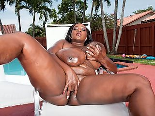 Oiled Swimsuit Babe : Hit the pool with Mahogany Masters for an afternoon of swimsuit, oiling and body-play action. A nice, sunny day with a lady like Mahogany makes everything A-OK.br br Its an unbelievable sight when Mahogany unties her pink bikini and it falls off her chest to reveal the rest of her twin wonders. Then the bottoms come off and Mahogany oils her 42K-cups until they shine in the sun. br br I hope you dont mind me going crazy with this oil, Mahogany said. Then her ass gets the same treatment. Did I get both sides? She has a very sexy voice and gives good eye-contact.br br Totally immersed in oil, Mahogany lies back on a deck chair and spreads her legs wide. Its time to give herself a hand party and cum in the sun.