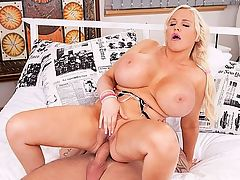 Ass-Crammed Blonde : Jordan Pryce is a little frustrated. Her blockhead of a companion isnt rushing over to her at bedside. Shes playing with her big tits and begging him to come over and fuck them. Fuck my huge boobs and my ass, Jordan cries in her throaty voice, smacking her pussy. Im horny today. When is Jordan not horny? br br Jordan turns on her side and pulls her booty cheeks apart so he can see the butt-plug all the way inside her asshole. Dont ya hate girls who play hard to get? Max is abrupt. Maybe later. br br Cmon, said Jordan, whipping the bed with her panties. Come here. Max gives in. In two seconds, Jordan is sucking his dick, making slurping and popping noises. She really loves dick in her mouth and between her tits. Jerking his shaft and licking his nut-sac, Jordan keeps repeating the word fuck and choking on cock.br br Jordan gets on her back to get her tits fucked again and choke on his cock on the upstroke between her heavy jugs. Shes one hell of an assertive girl. Max has her get into a doggie position so he can finger-bang her pussy before he lays the pipe to her. Fuck my ass, Jordan pleads. br br Max takes the butt-plug out of her ass and puts it in her mouth so she can taste her own ass juices. Jordan assumes the position again and Max pounds her pussy first then replaces the butt-plug with his meat-pipe to fuck the horniness out of her, at least for a while.