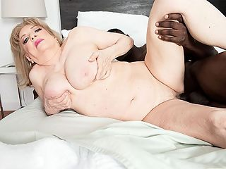 Private time with Crystal and a BBC : Im a very private woman, said 70-year-old divorcee Crystal King from New Jersey.br br Here, Crystal invites us into her private bedroom, where she summons 28-year-old Jax. She doesnt waste any time before shes pulling his big, black cock out of his pants and sucking it, keeping her glasses on and making those humming and moaning noises we all love so much. She tenderly strokes his balls, too. Why tenderly? Because Crystal is a very nice woman.br br Crystal used to be a dominatrix. Shes from New Jersey and was sent our way by 60Plus MILF Kokie del Coco. Theyre friends. They even had a threesome together with another guy. Crystal is like Sandra Ann, our oldest GILF ever, in that youd never imagine by looking at them that they do these things on-camera. They look so...grandmotherly. But then they idoi do these things on-camera, and thats great.br br More about Crystalbr br She volunteers for the Salvation Army.br br She enjoys fine dining. Take her to a nice restaurant in New York City.br br She goes for kind men with nice smiles.br br She has done legal work for most of her life.br br She describes herself as sexually assertive.br br And until she came here, shed never had sex with a really young guy.br br Which just goes to prove that even when a woman hits age 70, she still has a lot of living to do.br