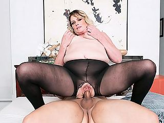 Fuck the MILF through her pantyhose! : All the young boys want me, said Tristen Cole, a 46-year-old divorcee and mom. This is Tristens first time fucking on-camera, and its a good one. Her fuck buddy tears open her pantyhose so he can eat and fuck her pussy. This voluptuous blonde from Miami, Florida by way of New York rides him hard and then gets down on her knees for a facial.br br How often does Tristen have sex?br br As often as I can, she said.br br That means as often as she pleases. Thats one of the benefits of being a hot MILF.br br She once fucked on the hood of a car.br br She has eaten pussy and had her pussy eaten.br br Shes been a saleswoman and a lifeguard.br br And now she can call herself a porn star.br br I was a cheerleader in high school and also played softball, Tristen said. I like to shop. I also like to read a good book.br br Shes not a swinger. Shes not a nudist. But she found her way here. Good thing. Welcome, Tristen. Enjoy the ride.