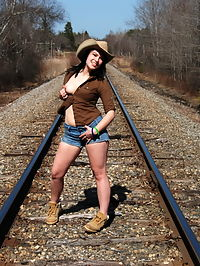 SpunkyAngels Spunky Angel Emily Love is not a shy girl as she gets almost completely naked outdoors on the train tracks : Spunky Angel Emily Love is not a shy girl as she gets almost completely naked outdoors on the train tracks