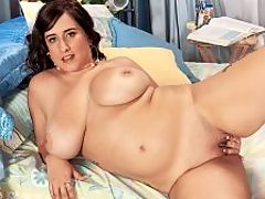 Kansas City Bomber : Carrie Ashton is a cuddly top-stretcher, a sweet-faced Kansas girl-next-door. In this video, after dousing her big, jiggling chest with water, Carrie energetically uses the bed like its a bounce house. br br Peeling off the wet blouse, Carrie rubs her big, natural tits that are capped by pierced nipples. For some reason, there was a big sex toy under the pillow. Carrie took it and vigorously masturbated with it.br br Carrie took to video very nicely and looks at home in front of a camera. A fellow boob man told Carrie all about iSCORELANDi and suggested she try posing. br br An ex-boyfriend of mine buys a lot of your videos and at the end of one there was this commercial to be a iSCOREi model and he saw it and convinced me to come and model for you guys. I thought, Hey, I can do that!