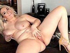 Watch Sandys big boobs hang and sway : In her first video for i40SomethingMag.comi, 46-year-old wife and mother Sandy, aka Sandy Bigboobs, shows off her hot body. Shes wearing the kind of outfit you might expect a sexy, mature woman to be wearing a cleavage-revealing top and shorts that are just the right length to show off her legs, short but not too short. Not sleazy, in other words. Shes wearing heels, too. Her tits are pouring out of her red bra, and before long, that bra comes off.br br One of the highlights of this scene is when Sandy, who has E-cup naturals, lets her tits hang and sway, and the camera, moving in for a close-up view, catches it in slo-motion. This kind of stuff is a real treat for you boob lovers out there, and the slo-mo action lasts long enough for you to get hard, enjoy and get off.br br Then Sandy deep-fingers her pussy, her hand slapping against her flesh, and you can hear how wet she is. You also get to see how pink she is. Sandy opens up her pussy nice and wide.br br After she cums, Sandy puts on a iSCOREi t-shirt and gets interviewed by her videographer. She tells us shes a webcam model back home in Germany.br br And I have big, natural boobies, she says. Im very proud to be here.br br Were proud to have her.