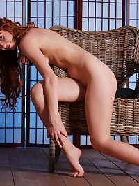 Soft Touch : Redhead Oxavia flaunts her sexy body with beautiful breasts and hairy pussy as she poses on the chair.