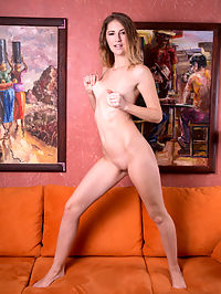 Amanda D : Amanda D bares her slender body with small tits as she poses in front of the camera.