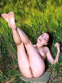 Nude Scenery : Gabriele shows off her sexy, slender body as she sensually poses on the rice field.