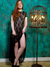 Candelabra : Redhead Anicka bares her smooth, creamy body and hairy pussy as she strips her black nightgown.