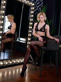 Nylons : Hilary Wind sensually strips in front of the mirror as she bares her amazing physique.