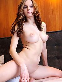 Ridola : Yuki sensually poses on the bed baring her big tits and yummy pussy.