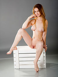 She stripped every inch of her clothing to reveal the most amazingly shaped body and a wet pussy.