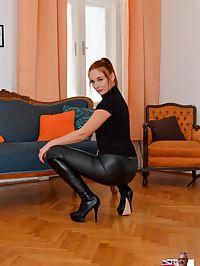 Superb Eva : Hot redhead babe Eva strip leather clothes and show assets