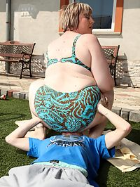 Chesty BBW : Big titted blonde BBW milf sitting on a guys face outdoors