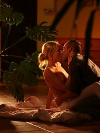 Romantic couple : Ponytailed blonde babe making love with her handsome partner