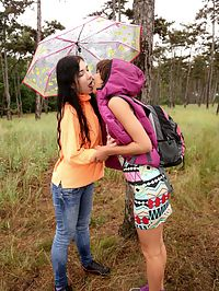 Busty lesbians : Young busty lesbian babes making out in the rain outdoors