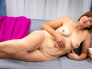 What You Want : Looking pretty in pink, Eleanor is a hot milf with a lovely body and short red hair. She cant get enough of flaunting her big boobs with their big nipples that grow hard at a touch. Her hairy snatch is dewy with her pussy juices as her hands explore the treasure between her thighs.