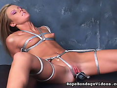 Spread Wide for the Camera : Is this really torture? Seems like shes enjoying it. Her arms are tied tight behind her back, her breasts are bound, and her legs are tied spreadeagle. Stiffies guaranteed!