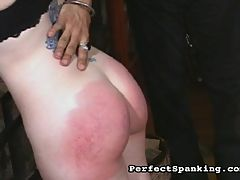 Cruel Spanking : The parole officer is called in to discipline two hard cases... The first is a brunette babe that moans and pouts as her attractive bum gets paddled and caned. The second shaved head babe has a beautiful round ass that is begging to be smacked, and by the end, it is bruised purple and throbbing.