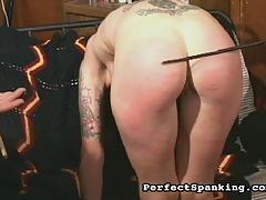 Caning and paddling : Mistress Gemini takes two hotties into her dungeon for a spanking torture session. Loads of hot OTK and paddling, and the stinging pain of the cane lash.