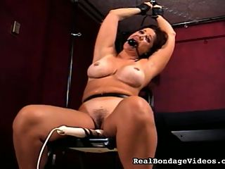 BBW Means Big Beautiful Whore : They say that with Big Beautiful Women there is more to love, but in the case of BBW Samantha, there is more of her to abuse. Watch as she is chained to the canopy bed and begs to be used like a whore. This chubbette is tied up, used, and abused. Her captor runs a dildo up and down her slit and then eases it into her cunny as we watch. He ties her up and whips her. Even her nipples are imprisoned. She is tied up with her hands over her head, and a vibrator is attached to her clit.