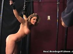 Big Time with Big Tits : This blonde has got a huge set of kazongas, and Baldy has her under his control, big tits and all. Baldy ties the blonde up and puts the vibrator on her. Then, untied, she uses the vibrator on herself, while Baldy urges her to go slowly. Baldy slaps her and whips her, immobilizes her legs, then commands her to crawl across the floor to where he has left the vibrator ... this even though her legs are tied so she cant put one knee in front of the other to propel herself across the floor. For every time you come, Im going to give you 20 lashes, he says. Is that a threat or a promise? She seems elated at the prospect!