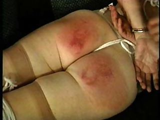 Granny gets spanked : Rosalind, a refined, 42 year old librarian from NY demonstrates that she has a serious affinity for pain. Quotes from Master Rick Savage This video contains the most intense, graphic action of any S and M video I have ever made! It contains extremely hard spanking and the most severe nipple torture I have ever witnessed in ANY S and M. As the video begins , simply the act of stripping before the camera , is obviously humiliating to Rosalind. After she is placed in bondage, she is taken over the knee for a hard fast paced spanking. After Savage reddens her ass cheeks with the palm of his hand, he pulls out a wooden hair brush, and a wooden sports paddle. Rosalinds ass is literally paddled purple right before our eyes. In the final scene, strong twine is tied to Rosalinds erect nipples and a heavy surprise weight is attached. As the weight increases, our view is breathtaking as her taut.