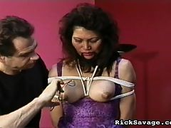 Vintage Bondage : Rosie, a pretty, oriental girl with firm muscular body is our newest victim as we find her kneeling on the floor in a submissive position. Rick conducts a clinic in rope tying by binding her wrists, knees and ankles and devises a constrictive, uncomffortable rope bra. Rosie writhes in pain as the Master kneads and pinches her ample breasts with cold metal ice tongs.We next find Rosie, nude and gagged, as she is tied face down to an examination table. Master Savage begins a strange combination of ass caressing then violently spanking her firm well rounded butt cheeks. After a vicous flogging, her genital areas are pricked and teased with a wortenberg wheel. The Master decides not to ignore our victims pretty feet as he punishes her soles with a rubber flogger.Finally, our Asian beauty adorned in black lingerie, is tied spread-eagled toa torture table. After attaching harsh metal clips to her swollen nipples, Master Savage teaches Rosie the meaning of pussy torture with ice tongs and wooden clothes pins.