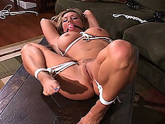 Dream Date : Whats every horny dudes fantasy? A busty blonde babe tied up and helpless. See this hot tramp moan and thrash as shes tied up on the couch, then laid out and bound to a table. Her big, round tits heave and strain against the ropes, just as they do every night in his fantasy
