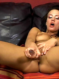 Chick stretches her ass with a dildo for anal sex