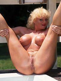 Mature big tit slut outdoors Mature Slut With Big Fake Tits Posing Naked Outdoors